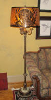 3 arm floor lamp with mica shade has metal cutout overlay scene