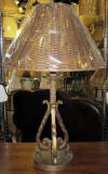Bronze iron lamp with oval wicker shade